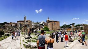 Rome, Lazio, Italy. July 25, 2017: Partial view of the ruins of. The forum of the time of the Roman Empire, with tourists visiting it Stock Photos