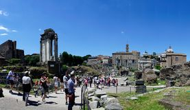 Rome, Lazio, Italy. July 25, 2017: Partial view of the ruins of. The forum of the time of the Roman Empire, with tourists visiting it Stock Images