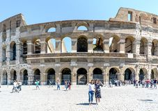 Rome, Lazio, Italy. July 25, 2017: Two young women photographed. In front of Roman Coliseum Stock Image