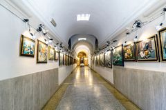 Corridor of an art gallery located on the street of Corso with stock images