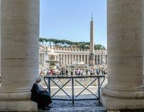 Rome, Lazio, Italy. May 25, 2017: Nun praying sitting on a colum