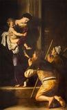 Rome - Madonna av Loreto och vallfärdar vid Caravaggio (1571 - 1610) i Basilika di Sant Agostino (Augustine) Arkivfoton