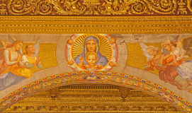 Rome - The Madonna fresco over the arch in church of Santa Maria in Trastevere from years 1865 - 1866. ROME, ITALY - MARCH 21, 2012: The Madonna fresco over the Royalty Free Stock Image