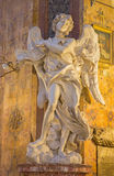 Rome - The marble statue of Angel with with the superscription  in church Basilica di Sant' Andrea delle Fratte by Bernini Stock Photos