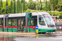 ROME - MAY 14, 2014: ATAC train speeds up in city cente. ATAC is Royalty Free Stock Photos