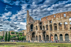 ROME - MAY 20, 2014: Tourists visit Colosseum. The city is visit Royalty Free Stock Photo