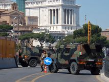 Rome - Military Presidency at Imperial Forums. Rome, Lazio, Italy - April 20, 2017: Two armored trucks of the Italian Army presiding over Imperial Forums during Stock Photos