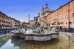 Rome Navona Neptune Along. Neptune fountain water and statues in front of St Agnese catholic church at Navona Square in Rome, Italy royalty free stock photo