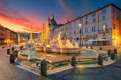 Rome, Navona Square. Cityscape image of Navona Square, Rome with Fountain of Neptune during beautiful sunrise royalty free stock photography