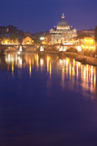 Rome by night. St Peter's Basilica in Rome, Italy, by night  - Tiber river on foreground Stock Images