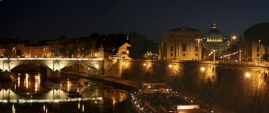Rome at night. The city Rome at night, with the river tiber and the St. Peter Cathedral Royalty Free Stock Photos