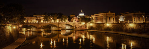 Rome at night. Basilica of San Pietro at night overlooking the Tevere river and surrounding historical landmarks of Rome royalty free stock image