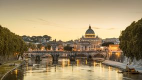 Rome at night, Italy. Sant`Angelo bridge and St Peter`s Basilica. Rome landmark. Saint Peter`s Basilica San Pietro is one of main travel attractions of Rome Royalty Free Stock Photography