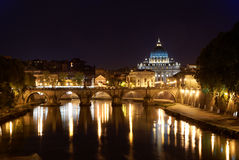 Rome by night: Saint Peter's Basilica in Vatican. Vatican city in Rome (Italy) by night, in particular Saint Peter's Basilica reflecting on the Tiber river Stock Images