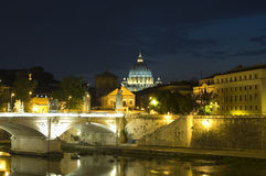 Rome night time view. Rome at night with lights shining on the River Tiber and Vittorio Emanuele II bridge in the foreground with St Peter's Basilica behind Royalty Free Stock Images