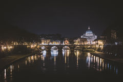 In Rome at night. Night view of Tiber river and St. Peter's Basilica from a bridge Royalty Free Stock Photo