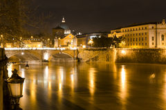 Rome by night. Vittorio Emanuele bridge. Rome by night. Tiber river, Vittorio Emanuele bridge and Dome of St. Peter in the Vatican city Stock Photo
