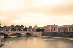 Rome panorama. Architectural panorama of Rome with Tiber river and Saint Peter's basilica in the background at sunset Royalty Free Stock Image