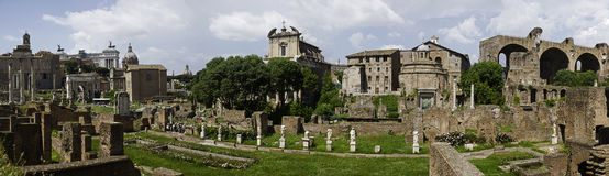 Rome - panoramic view of the roman forum. An high resolution view of the ancient city of Rome (10.000 pixel large). Ruin of several temple with columns and Stock Photography