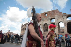 Rome Parade Actor Carrying a Fasce. An actor dressed as Lictor, and carrying a fasce in front of the Colosseum as part of a parade and re-enactment to celebrate Stock Photography