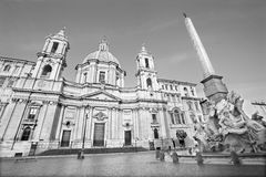 Rome - Piazza Navona in morning and Fontana dei Fiumi by Bernini and Egypts obelisk and Santa Agnese in Agone Royalty Free Stock Image