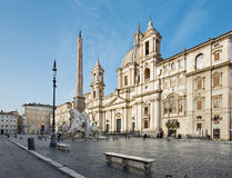 Rome - Piazza Navona in morning and Fontana dei Fiumi by Bernini and Egypts obelisk and Santa Agnese in Agone church Stock Photos