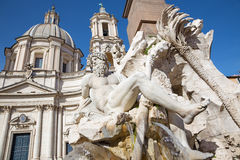 Rome - Piazza Navona in morning and Fontana dei Fiumi by Bernini and Santa Agnese in Agone church. The statue of Ganga river Stock Photos