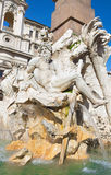 Rome - Piazza Navona in morning and Fontana dei Fiumi and Santa Agnese in Agone church. The statue of Ganga river Royalty Free Stock Photography