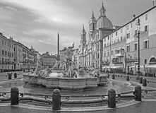 Rome - Piazza Navona in morning and Fountain of Neptune created by Giacomo della Porta and Santa Agnese in Agone church Stock Image