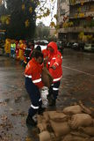 Rome prepares to overflowing ot Tiber. Volunteers working near the Tiber in full Royalty Free Stock Photo