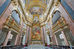 Rome - presbyter of baroque church Basilica dei Santi Ambrogio e Carlo al Corso. Royalty Free Stock Photo
