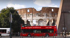 Rome red tour bus Colosseum Royalty Free Stock Photos
