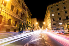 Rome road at night, urban traffic light trails and citylife. Italy. Road of Rome at night and cars light trails. With urban traffic. Corso Vittorio Emanuele II Royalty Free Stock Photography