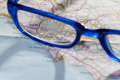 Rome roadmap. Photo of road map for Rome with blue glasses Royalty Free Stock Photography