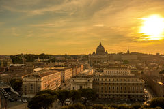 Rome rooftop view with ancient architecture in Italy at sunrise. Panorama of Rome and Basilica of St. Peter at sunrise in Vatican royalty free stock image