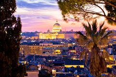 Rome rooftops and dome of the Papal Basilica of Saint Peter in Vatican evening view. Capital city of Italy stock images