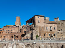Rome. Ruins of a forum of Trajan.city landscape against the blue sky Stock Photos