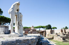 Rome. Ruins of Ostia antica. Rome, Italy. 15 august 2016. Ruins of Ostia antica, Italy. Republican sacred area, statue of Hercules Royalty Free Stock Photo