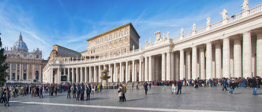 Rome Saint Peters Square 01. VATICAN CITY, VATICAN - JANUARY 8: Tourists at Saint Peter's Square on January 8, 2014 in Vatican City, with People waiting to into Stock Images