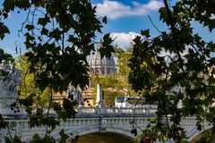 Rome, San Pietro seen between the branches with the bridge of the angels. stock photography