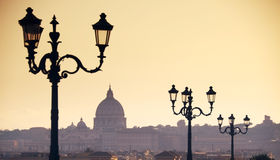Rome skyline. With Saint Peter Basilica in Vatican. Street lamp in the foreground, this is a view you get from Borghese Villa Stock Photography