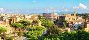 Rome Skyline with Colosseum and Roman Forum, Italy. Rome, Italy city skyline with landmarks of the Ancient Rome ; Colosseum and Roman Forum, the famous travel stock photography