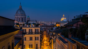 Rome Skyline from Spanish Steps. Dawn over Rome as seen from the Spanish Steps with St. Peters Basilica in the background royalty free stock images