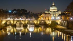Rome skyline st.peter basilica vatican city as seen from tiber river. Time lapse illuminated by night lights at dusk hour in Italy stock video footage
