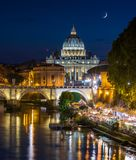 Rome skyline in a summer evening, as seen from Umberto I bridge, with Saint Peter Basilica in the background. stock photo