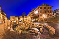 Rome Spanish Steps Boat fount. Spanish steps square and boat shaped fountain in Rome, Italy, at sunrise.Historic architecture of old palaces and houses Royalty Free Stock Photos