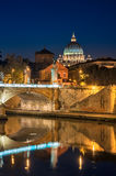 Rome, St. Peter's, night landscape. View on Tiber and St Peter's Basilica with the Bridge of Angels. Vertical Stock Images
