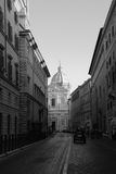Rome Street. View of an old street in Rome with an axial view of a cathedral in the distance Stock Photo