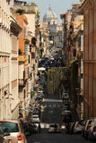 Rome street. A street in Rome during early morning. Quiet and peaceful, very picturesque. Seen in the distance is the papal church: Santa Maria Maggiore Royalty Free Stock Photography