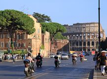 Rome street with motor scooters. And Coliseum Stock Images